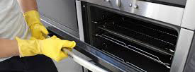 person with yellow gloves opens oven